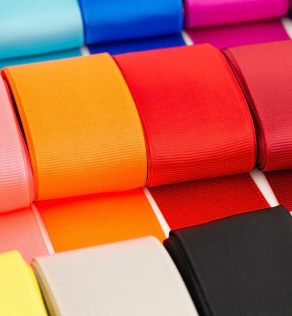 Several rolls of different colored grossgrain tape