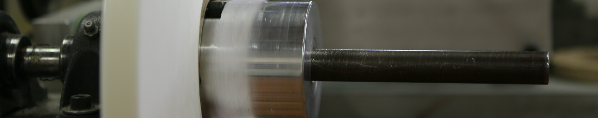 Close up of manufacturing equipment developing a custom fabric coating