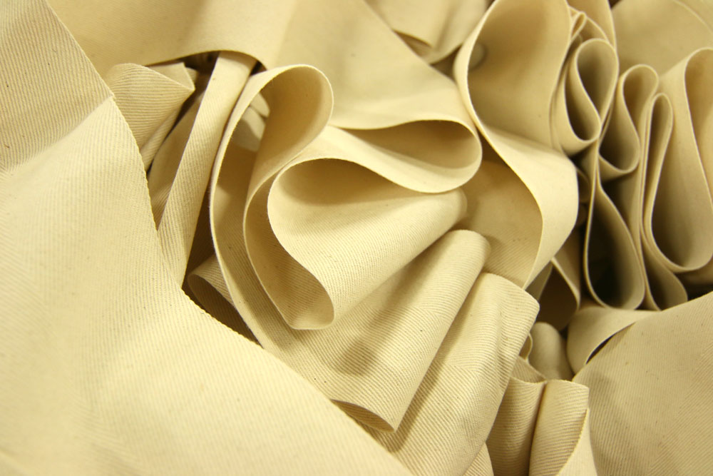 A large heap of faded yellow fabric