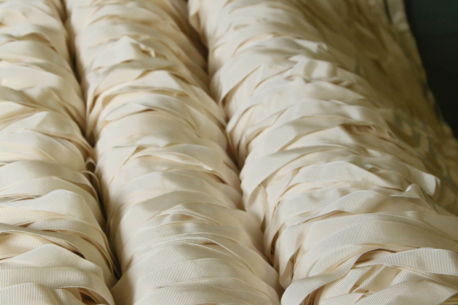 Long pieces of white fabric laying on top of each other