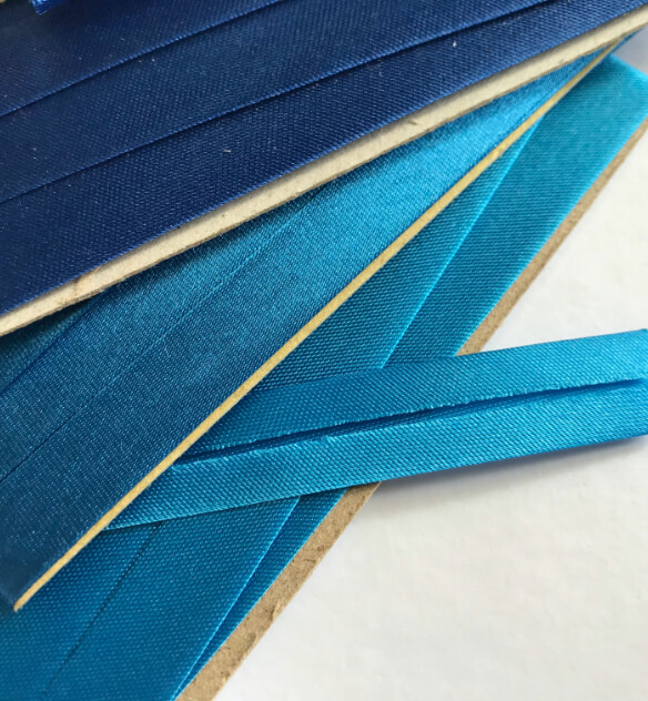 Several pieces of binding webbing each of which are colored a different shade of blue